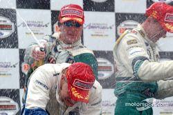 Podium: champagne for Mario Dominguez, Roberto Moreno and Mika Salo