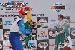 Podium: champagne for Paul Tracy, Sébastien Bourdais and Mario Dominguez