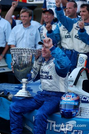 Podium: 2003 Champ Car champion Paul Tracy celebrates with his team