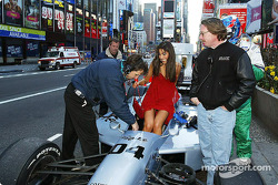 Ryan Hunter-Reay looks as the model tries to get seated in the two-seater Champ Car