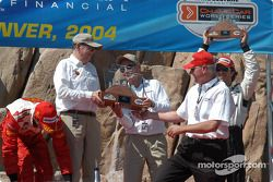 Podium: trophy presented to Carl Haas and Paul Newman