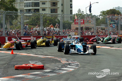 Start: Paul Tracy leads the field while Sébastien Bourdais cuts through the chicane
