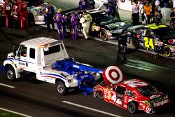 Car of Juan Pablo Montoya, Earnhardt Ganassi Racing Chevrolet towed back to the garage