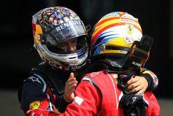 Second place Sebastian Vettel, Red Bull Racing, race winner Fernando Alonso, Scuderia Ferrari