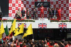 Podium: race winner Fernando Alonso, Scuderia Ferrari, second place Sebastian Vettel, Red Bull Racing, third place Mark Webber, Red Bull Racing