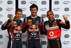 Pole winner Mark Webber, Red Bull Racing, with second place Lewis Hamilton, McLaren Mercedes, and th