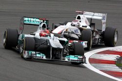 Michael Schumacher, Mercedes GP F1 Team, Kamui Kobayashi, Sauber F1 Team