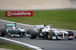 Nico Rosberg, Mercedes GP F1 Team en Kamui Kobayashi, Sauber F1 Team