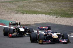 Sebastien Buemi, Scuderia Toro Rosso leads Nick Heidfeld, Lotus Renault GP