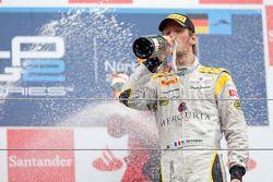 Romain Grosjean celebrates his victory on the podium