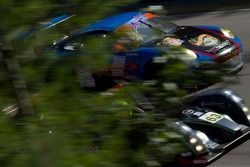 TRG's Porsche 911 GT3 Cup and Genoa Racing's Oreca FLM09 behind the trees