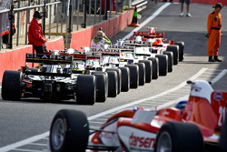 F2 cars line up in the pit lane