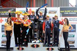 GT podium: class winners Jonathan Bomarito and Sylvain Tremblay, second place Memo Gidley and Wayne Nonnamaker, third place Dane Cameron and James Gue