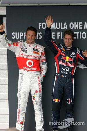 Jenson Button, McLaren Mercedes y Sebastian Vettel, Red Bull Racing