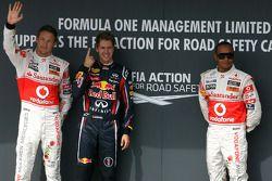 Jenson Button, McLaren Mercedes, Sebastian Vettel, Red Bull Racing y Lewis Hamilton, McLaren Mercede