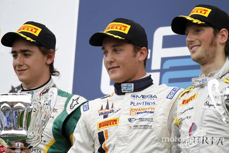 Stefano Coletti celebrates his victory on the podium with Esteban Gutierrez and Romain Grosjean