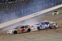 Ricky Stenhouse Jr. blows an engine on the last lap as second place, Carl Edwards slams into the rear of the car, pushing Ricky passed the checkered flag