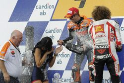Podium: race winner Casey Stoner, Repsol Honda Team, third place Marco Simoncelli, San Carlo Honda G