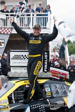 Victory lane: race winner Marcos Ambrose, Petty Motorsport Ford celebrates
