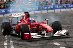 Marc Gene demonstrates the Scuderia Ferrari F150 Italia