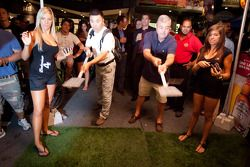 Crescent street racing party: fans play flip the burger
