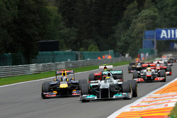 Nico Rosberg, Mercedes GP passes Sebastian Vettel, Red Bull Racing