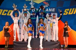 GT podium: class winners Wolf Henzler and Bryan Sellers, second place Dirk Müller and Joey Hand, thi