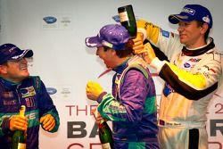 GT podium: class winner Wolf Henzler gets sprayed with champagne