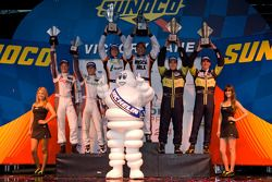 LMPC podium: class winners Kyle Marcelli and Tomy Drissi, second place Eric Lux and Elton Julian, third place Jon Bennett and Frankie Montecalvo
