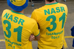 Members of the team have shirts made to celebrate the championship win of Nasr