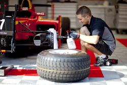 A Racing Engineering mechanic works on Dani Clos car