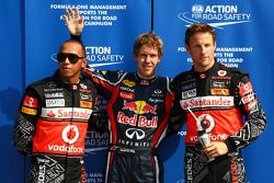 El 'poleman'- Sebastian Vettel, Red Bull Racing, segundo Lewis Hamilton, McLaren Mercedes, tercero J