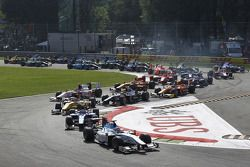 Charles Pic leads Alvaro Parente, Romain Grosjean and the rest of the field through turn one
