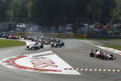 Luca Filippi leads Charles Pic, Alvaro Parente and the rest of the field into turn one on the openin
