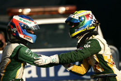 Valtteri Bottas celebrates victory in the race and winning the driers championship in parc ferme with James Calado