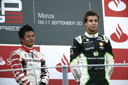 Antonio Felix Da Costa celebrates victory on the podium with Rio Haryanto