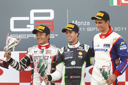 Antonio Felix Da Costa celebrates victory on the podium with Rio Haryanto and Nico Muller