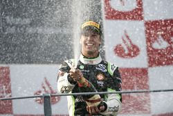 Antonio Felix Da Costa celebrates victory on the podium
