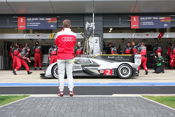 Allan McNish watches over his team
