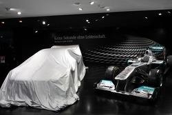 The new 2012 DTM AMG Mercedes C-Coupé under veil with the Mercedes GP Petronas F1 car