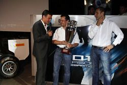 Will Buxton presents the winning GP3 teams trophy to Guillarne Capictto from Lotus ART with Bruno Mi