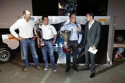 Guillarne Capictto from Lotus ART collects the winning GP3 teams trophy with Valtteri Bottas, collec