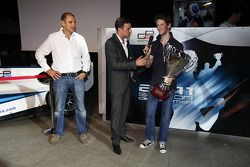 Bruno Michel and Will Buxton with 2011 GP2 Series Champion Romain Grosjean collects the GP2 Champion