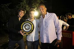 Davide Valsecchi and Luiz Razia collect their award for winning the Pirelli simulator challenge