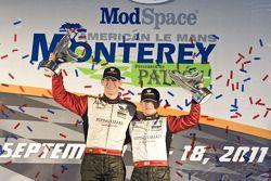 GT podium: class winner Jörg Bergmeister, Patrick Long