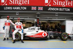 Jenson Button, McLaren Mercedes and Lewis Hamilton, McLaren Mercedes with a new sponser Lucozade