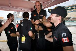 Ferrari of Québec team members celebrate victory