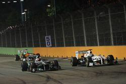 Michael Schumacher, Mercedes GP F1 Team en Kamui Kobayashi, Sauber F1 Team