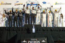 P2 podium: class winners Scott Tucker, Christophe Bouchut and Joao Barbosa, second place Zak Brown,