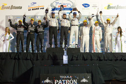 P2 podium: class winners Scott Tucker, Christophe Bouchut and Joao Barbosa, second place Zak Brown,